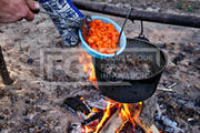 Outdoor cooking. Making food on a fire in a pot