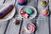 Beautiful sweets pastel shades on a beautiful wooden background.Aesthetic picture. dining, cooking, for children's parties