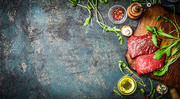 Raw Beef steak and fresh ingredients for cooking on rustic background, top view, banner.  Healthy and diet food concept.