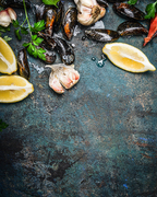 mussels with lemon and ingredients for cooking , top view, place for text. Seafood concept