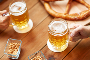 brewery, drinks and alcohol concept - close up of old beer barrel, glasses and bag with malt on wooden table