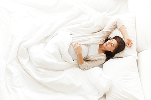 pregnancy, rest, people and expectation concept - happy pregnant woman sleeping in bed at home