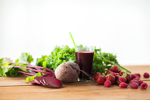 healthy eating, food, dieting and vegetarian concept - glass of beetroot juice, fruits and vegetables on wooden table