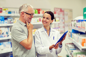 medicine, pharmaceutics, health care and people concept - happy pharmacist with tablet pc computer and senior man customer at drugstore