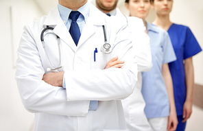 clinic, profession, people, healthcare and medicine concept - close up of medics or doctors at hospital corridor