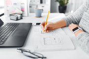 app design, technology and business concept - web designer or developer with smart watch working on user interface and drawing sketches at office