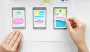 app design, technology and business concept - web designer working on user interface and creating wireframe layout at office