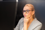 business, overwork, deadline and people concept - businesswoman in glasses working at computer in night office
