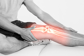Digital composite of Highlighted knee of injured man