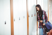 Restless student standing next the locker at the university