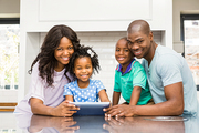 Happy family using tablet in the kitchen
