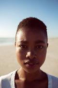 Portrait of beautiful African-american woman standing on the beach