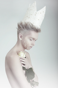 Creative Concept. Man in Crown with Flowers