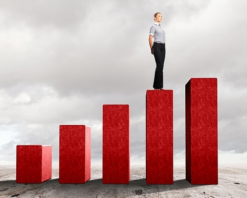 Business person on a graph|representing success and growth