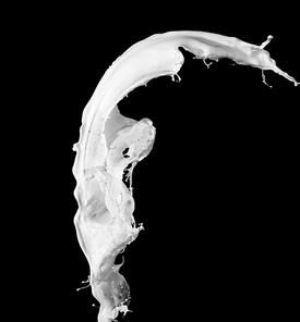 White milk splash isolated on black background