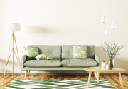 Modern interior of living room with green sofa, wooden coffee table,rug and floor lamp 3d rendering