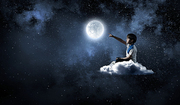 Cute school boy sitting on cloud and touching moon with finger