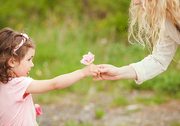 Daughter gives a flower for mom, Mothers day