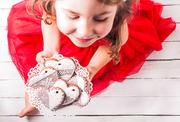 Gingerbread cookies in shape of heart in girl's hands