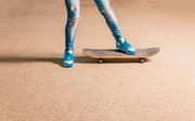 Legs of sporty woman on skateboard a lot of copyspace
