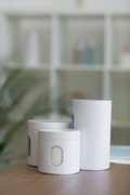 White cans on table in medical office