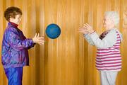 Senior women playing catch