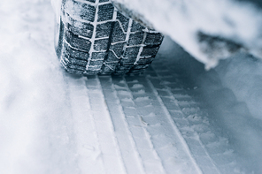All-season tyre track on snow, winter tire concept