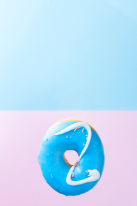mix of sweet doughnuts on gray stone background