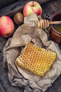 Still life with honeycombs on  crumpled paper in rustic style