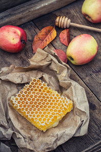 Still life with honeycombs apples and autumn leaves