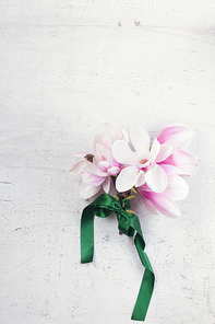 Magnolia flowers bouquet flat lay composition on white wooden background