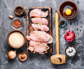 Raw chicken steaks on a kitchen board.Fresh and raw meat.
