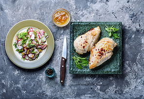 Baked chicken breast stuffed with greens.Delicious chicken with herb