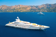 Aerial view of luxury yacht and blue sea at sunny bright day in summer. Big white modern boat. Top view of beautiful futuristic yacht, bay, mountains, clear water, sky. Travel in Croatia. Adriatic sea