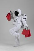 우주 생활 - 쇼핑백 들고 즐겁게 춤추는 우주인 옆모습 전신