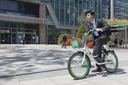 청년 신입사원의 하루 -  막대사탕을 물고 공유 자전거로 출근을 하는 활기찬 청년 신입사원