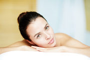 Calm girl enjoying spa therapy in luxurious salon or resort