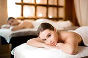 Calm girl lying in spa salon and relaxing before or after body massage