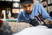 Master of tattoing concentrating during work