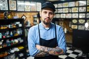 Master of tattoo art in his salon