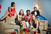 Posh young people toasting with champagne at home party