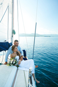 Young newlyweds traveling by yacht during voyage