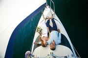 Romantic couple floating on yacht