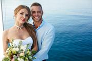 Amorous husband and wife enjoying honeymoon cruise