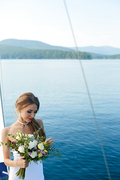 Bride with rose bunch on background of lake