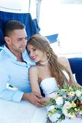 Serene and peaceful couple enjoying their honeymoon on yacht