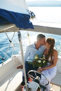 Bride and groom kissing while traveling on yacht