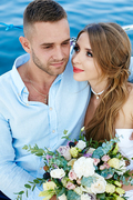 Amorous girl looking at her husband during honeymoon