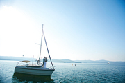 Yacht with newlyweds floating on lake water