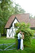 Newlyweds embracing in natural environment by green bush